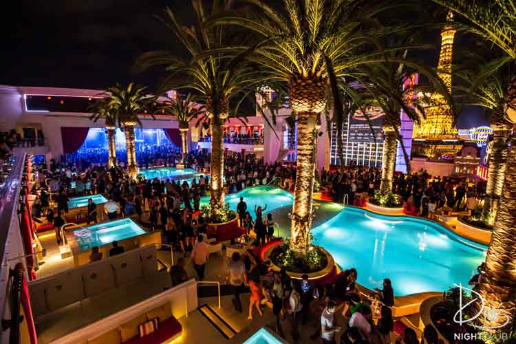 The crowd gathers around the pools at Drais. The Las Vegas strip can be seen in the background.