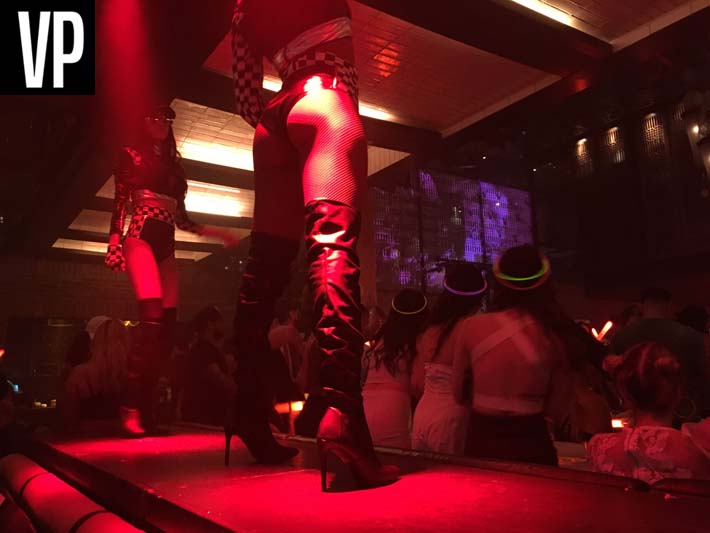 Go-go dancers perform on top of tables at Lavo Party Brunch