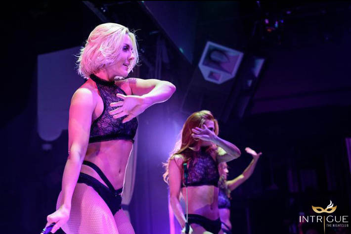 Dancers perform a burlesque style show at Intrigue Nightclub