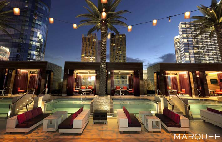 A photo of marquee nightclub's patio tables overlooking the marquee pool