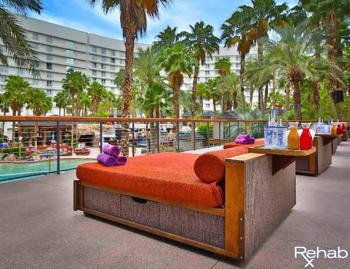 A picture of the daybed deck bottle service tables at Rehab Pool Party