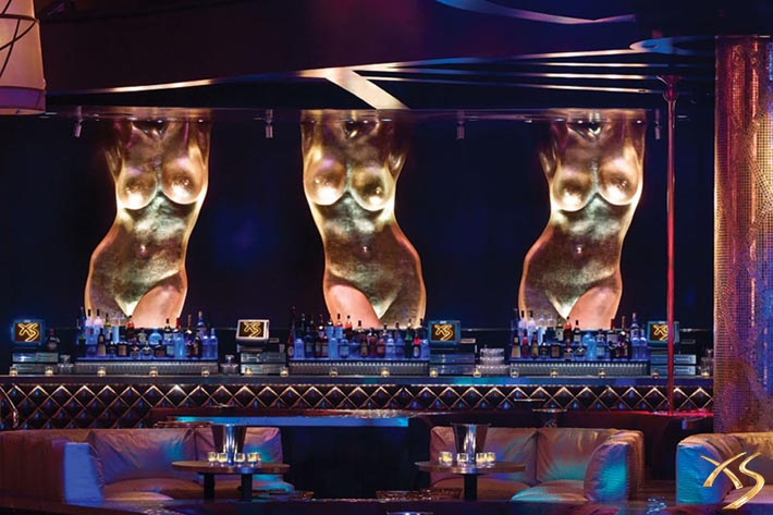 Statues of women's bodies are featured behind the bar at XS Las Vegas