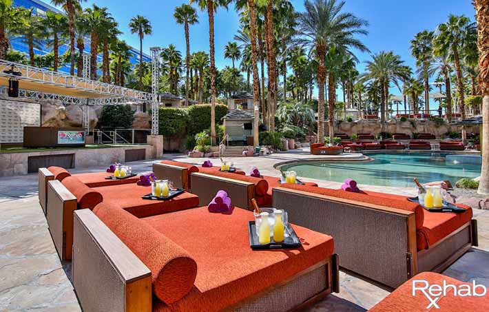 A photo showing what the pool deck daybeds look like at Rehab Pool Party