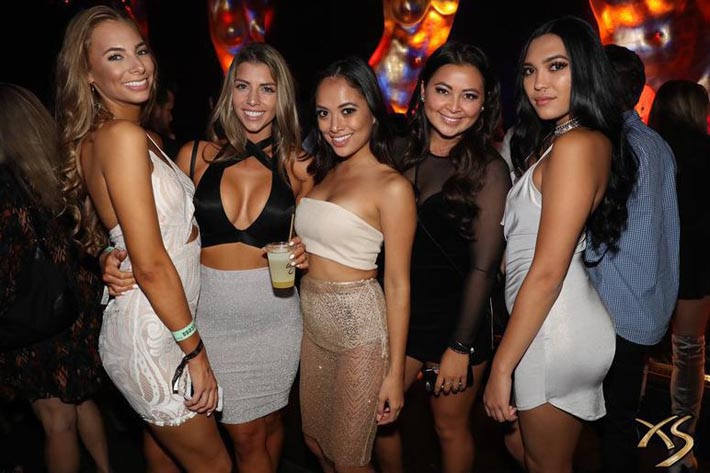 Photo of ladies in dresses and skirts at XS Nightclub