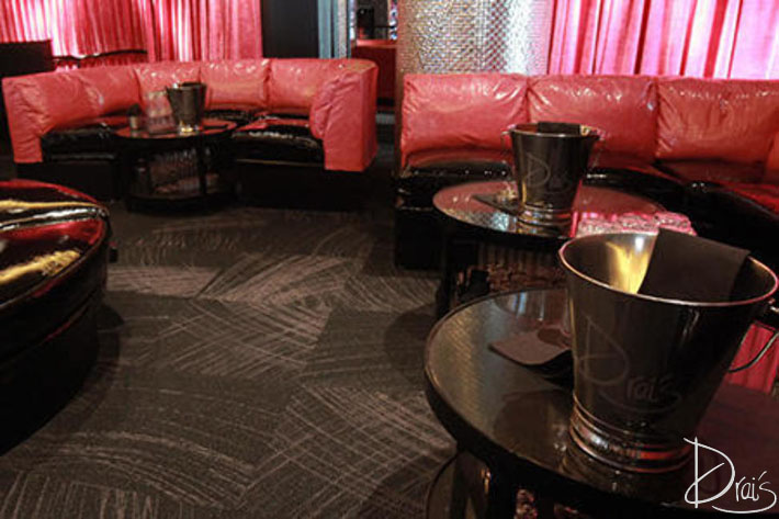 Red and black couches overlooking the Drai's dance floor.