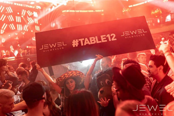 A photo of industry people including VIP hosts and cocktail servers at Table 12 during industry night at Jewel Nightclub.