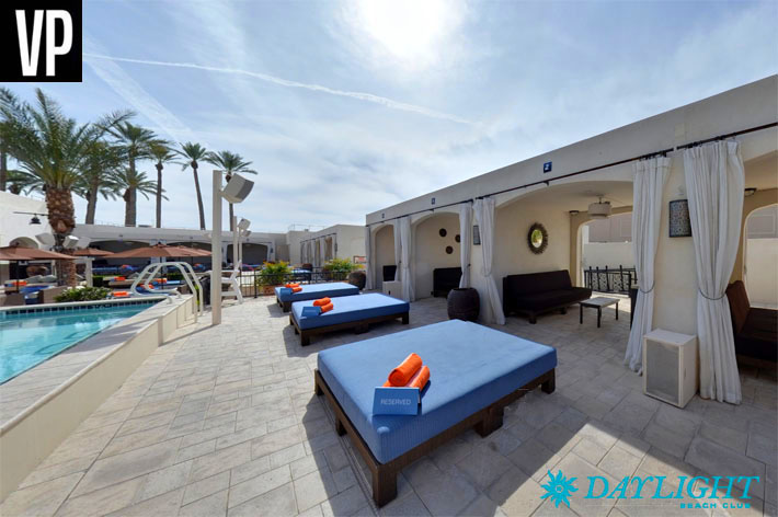 A photo of Daylight's cabanas featuring a couch, a daybed, and access to a VIP pool.