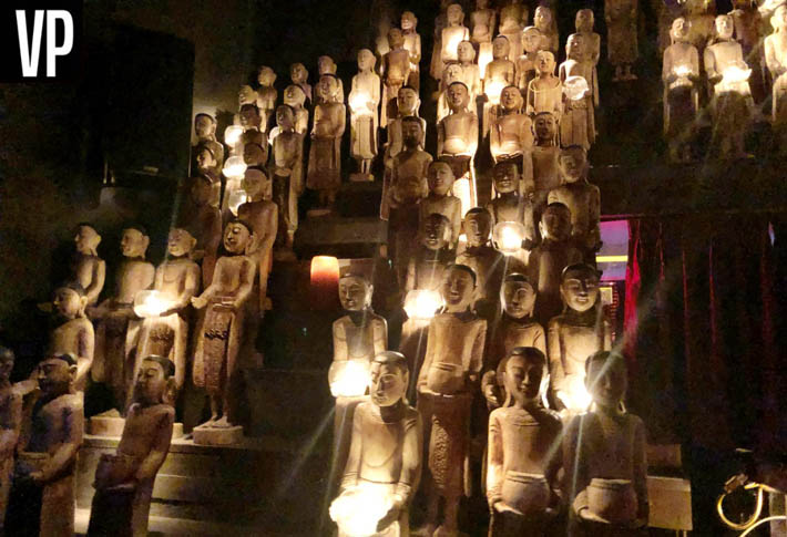 Statues are holding candles at Tao Las Vegas.