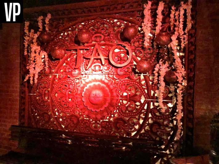 A bench and the Tao logo