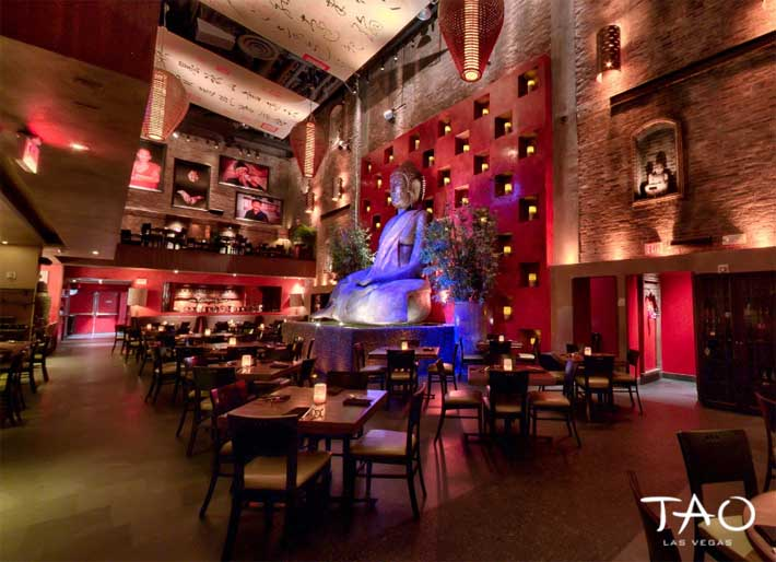 A photo of the dining room and Buddha statue inside Tao Restaurant