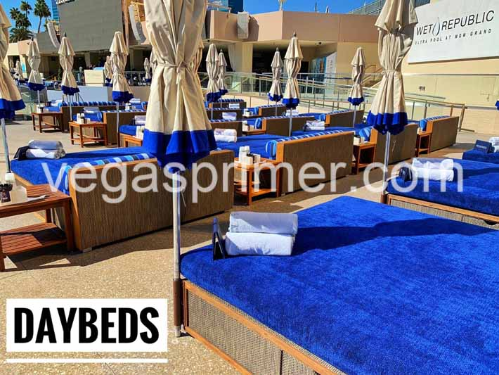 Rows of blue daybeds with umbrellas at Wet Republic in Las Vegas