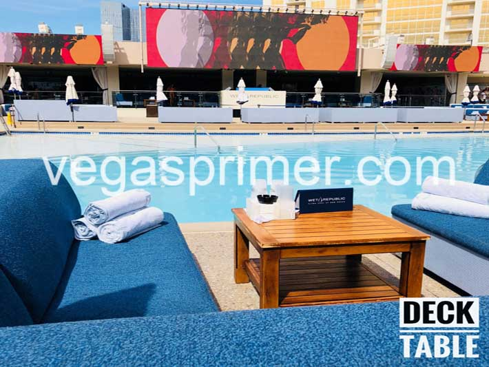 The Deck Tables overlook the main pool and DJ booth at Wet Republic Las Vegas