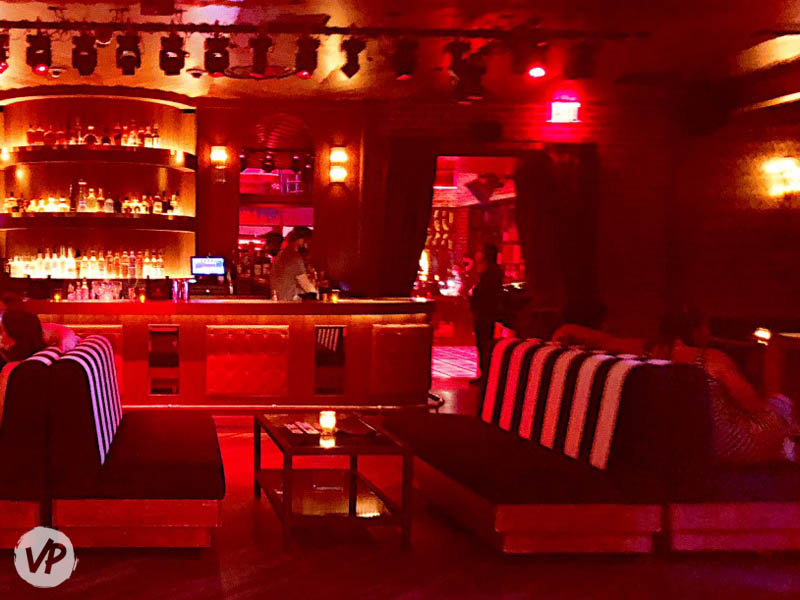 A photo of bottle service tables in On The Record's living room